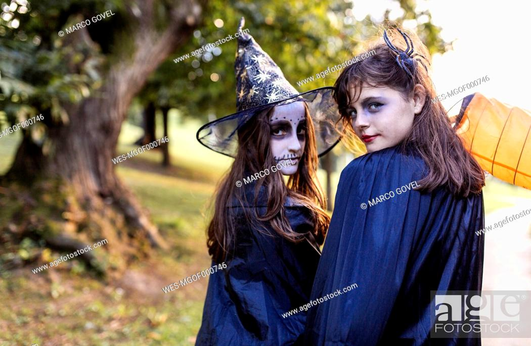 Stock Photo: Portrait of two masquerade girls at Halloween.