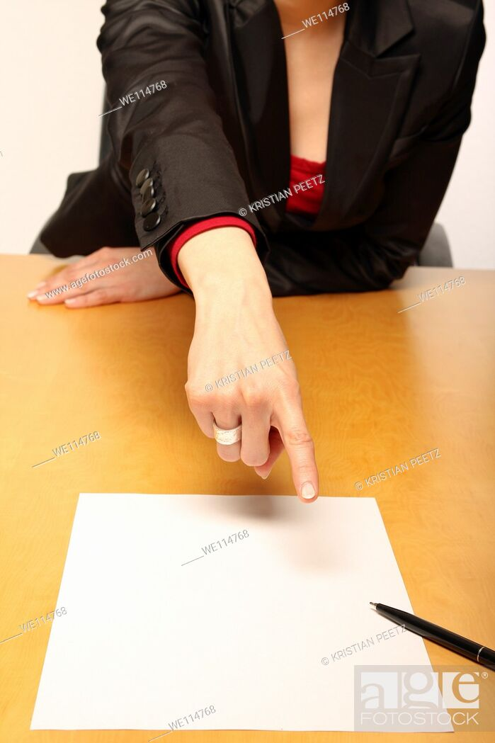 Stock Photo: View of a business-woman sitting at the desk infront of blank paper and gesturing.