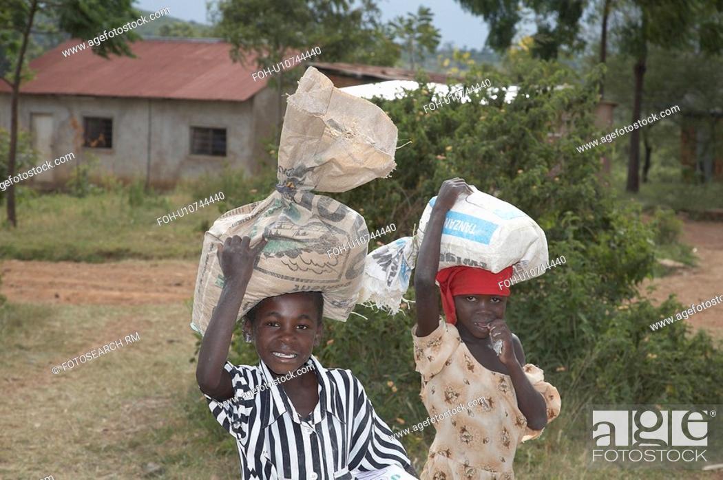 Stock Photo: food people child person children tanzania maize.
