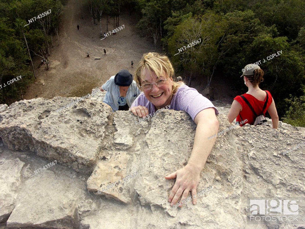 Stock Photo: Tourists climbing the Temple of the Churches in Coba, ruined city of the Pre-Columbian Maya civilization (600 A.D.). Quintana Roo, Mexico.