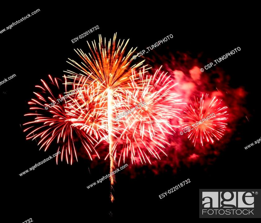 Stock Photo: fireworks on black sky background.