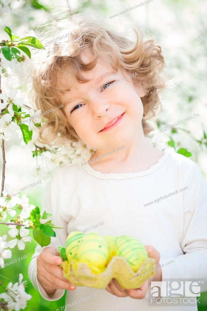 Stock Photo: Child holding Easter eggs.