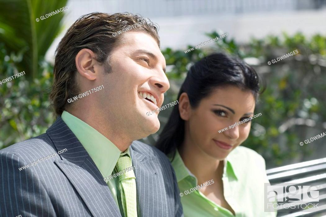 Stock Photo: Close-up of a businessman smiling with a businesswoman.
