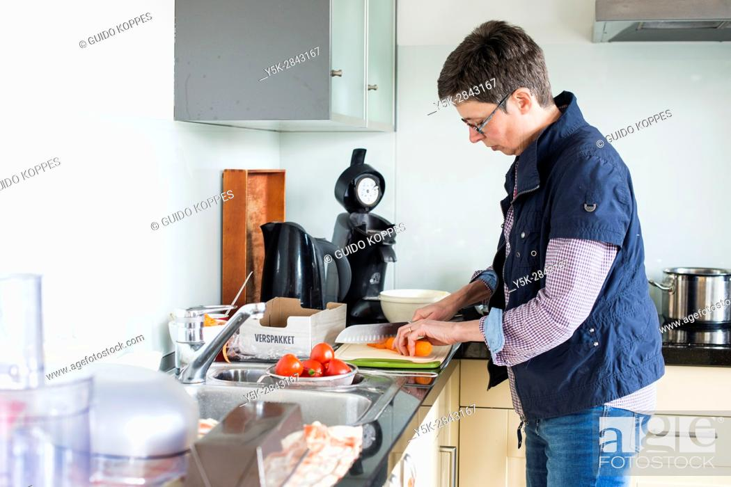 Stock Photo: Tilburg, Netherlands. Mid adult caucasian woman, having multiple sclerosis or MS for over a decade, succesfully halting the disease by eating and drinking very.