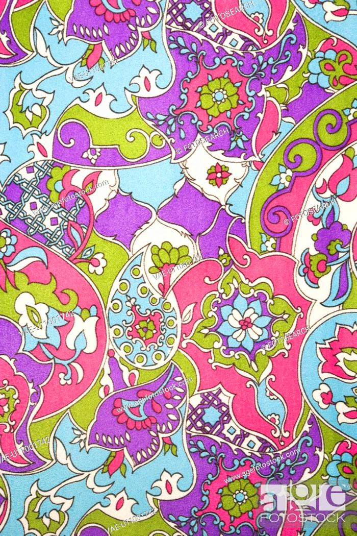 Stock Photo: Close-up of colorful vintage fabric with flowers and shapes printed on polyester.