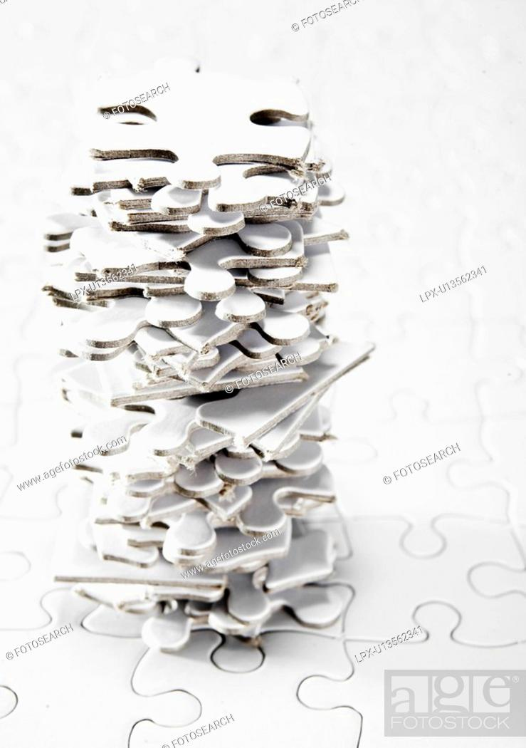 Stock Photo: Stack of White Jigsaw Pieces.