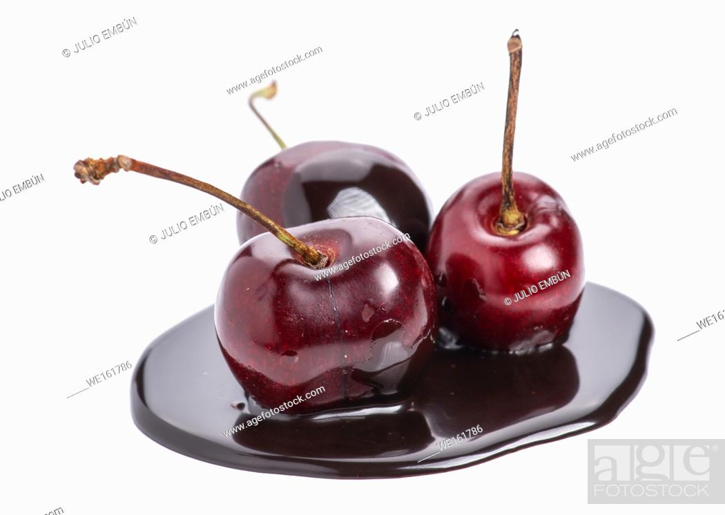 Stock Photo: group of cherries in chocolate puddle isolated on white.