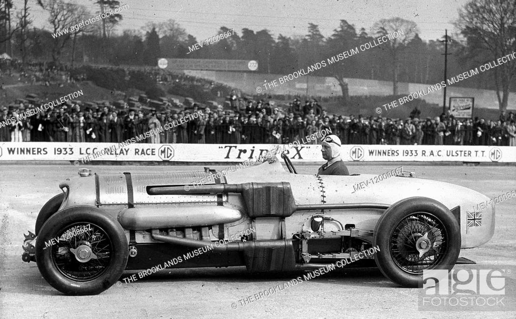 Stock Photo: Brooklands - John Cobb in the Napier-Railton - 1933-4.