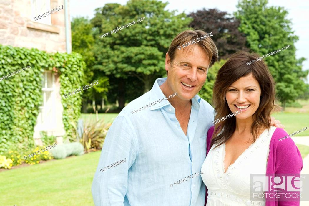 Stock Photo: Mature couple in gardens.