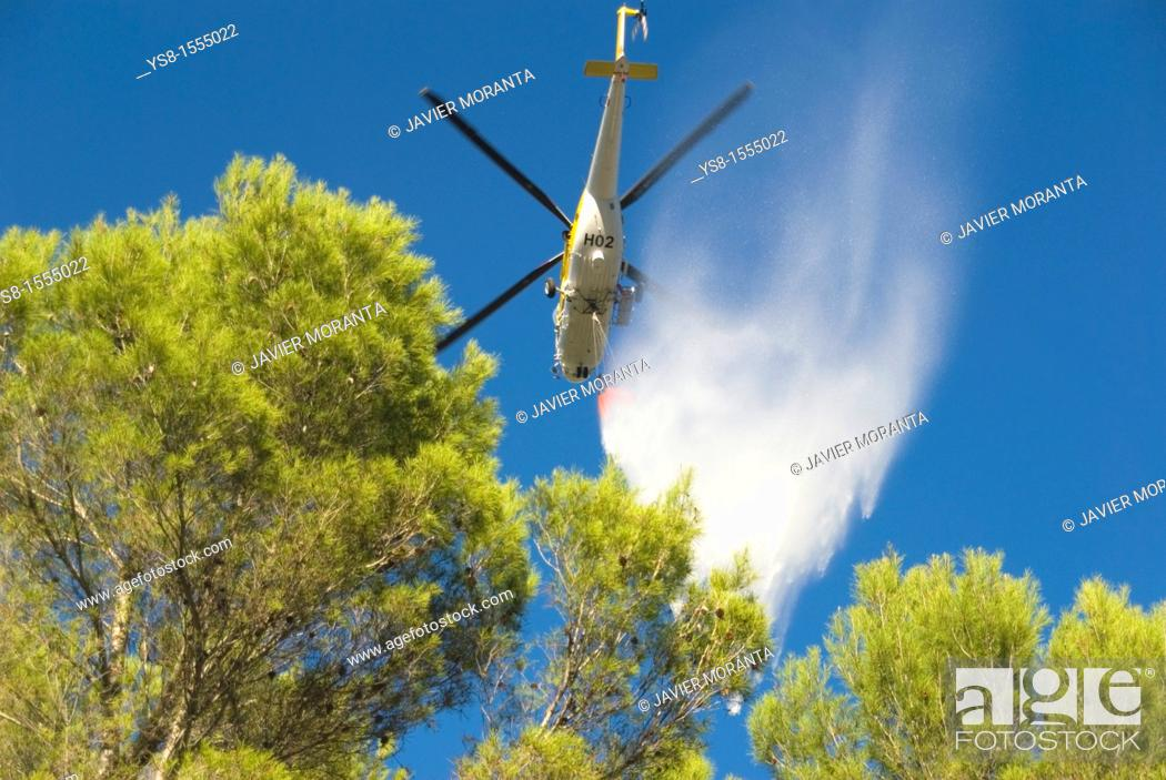 Stock Photo: Spain, Balearic Islands, Mallorca, Helicopter stifling wildfire.