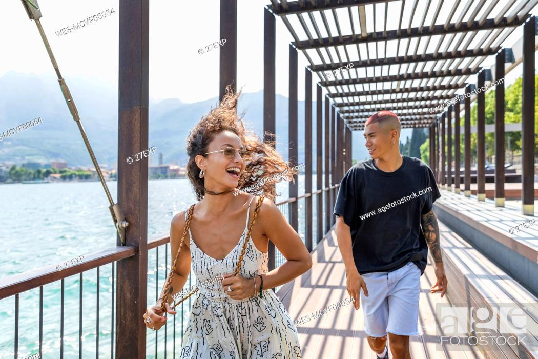 Stock Photo: Happy young couple on lakeside promenade, Lecco, Italy.