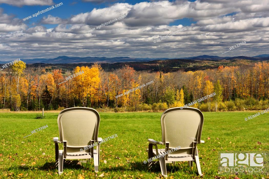Stock Photo: Two lawn chairs at Green Bay Loop overlooking Peacham and Barnet hills Vermont with Fall colors.