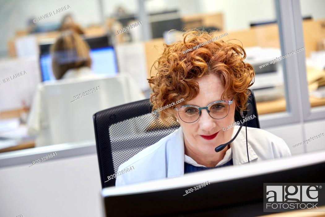 Stock Photo: Telephonist, ICC, Integrated Call Center, CIAT, Centro Integrado de Atención Telefónica, Hospital Donostia, San Sebastian, Gipuzkoa, Basque Country, Spain.