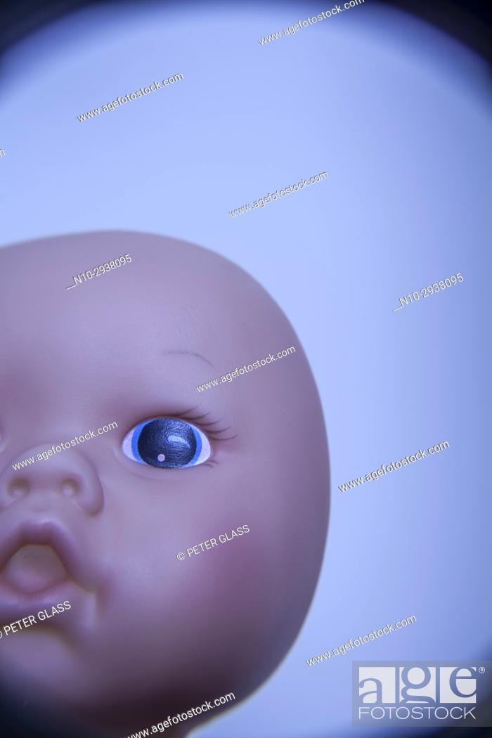 Stock Photo: Close-up of a doll's face.