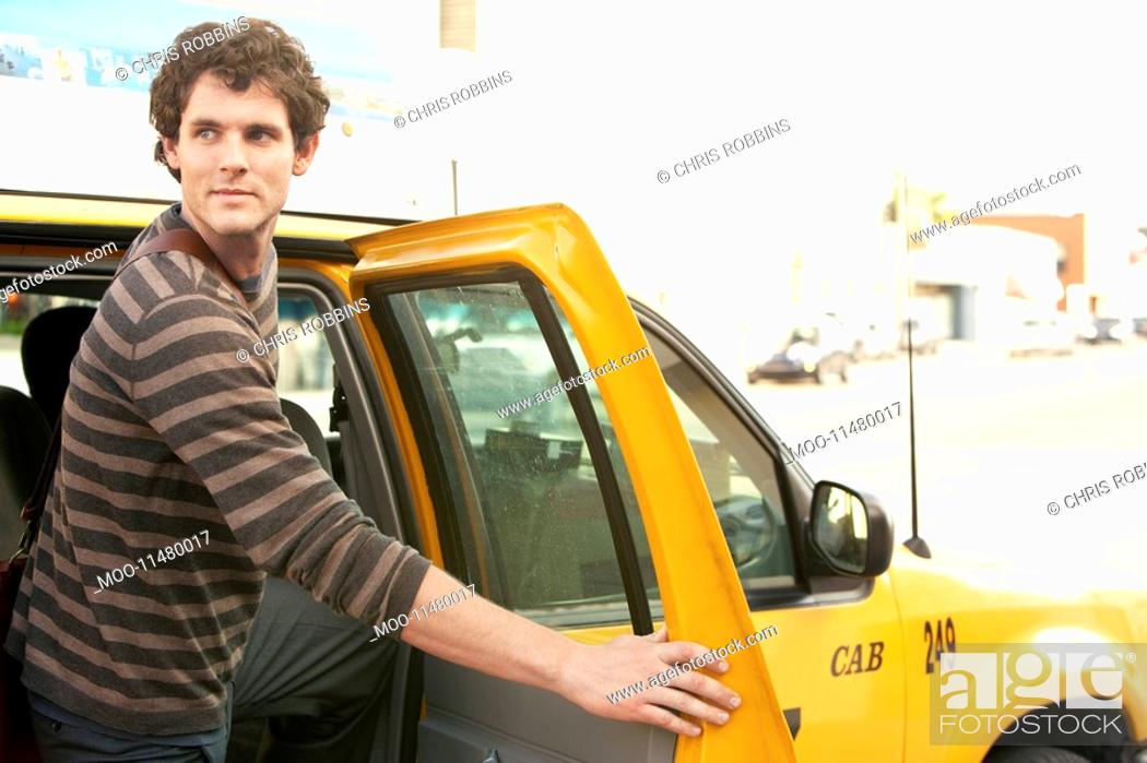 Stock Photo: Man exiting taxi in street.