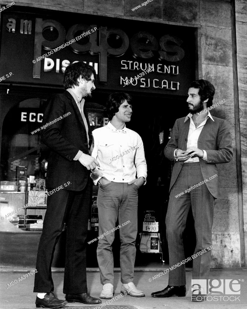 Enrico Maria Papes.Enrico Maria Papes Outside His Record Store With Sergio Di