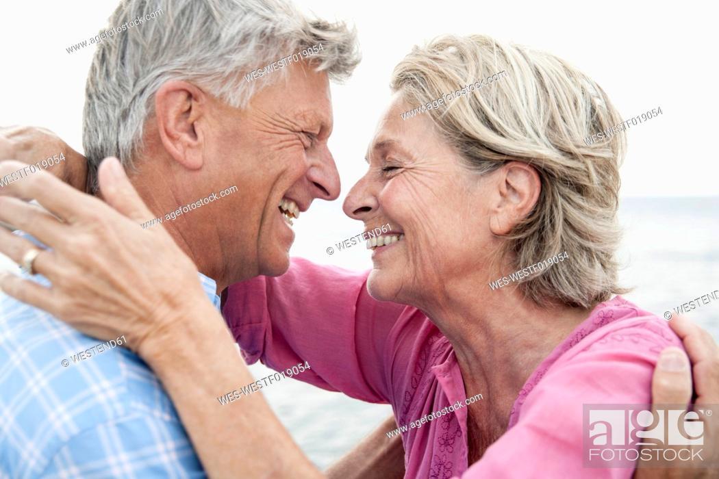 Stock Photo: Spain, Senior couple smiling, close up.