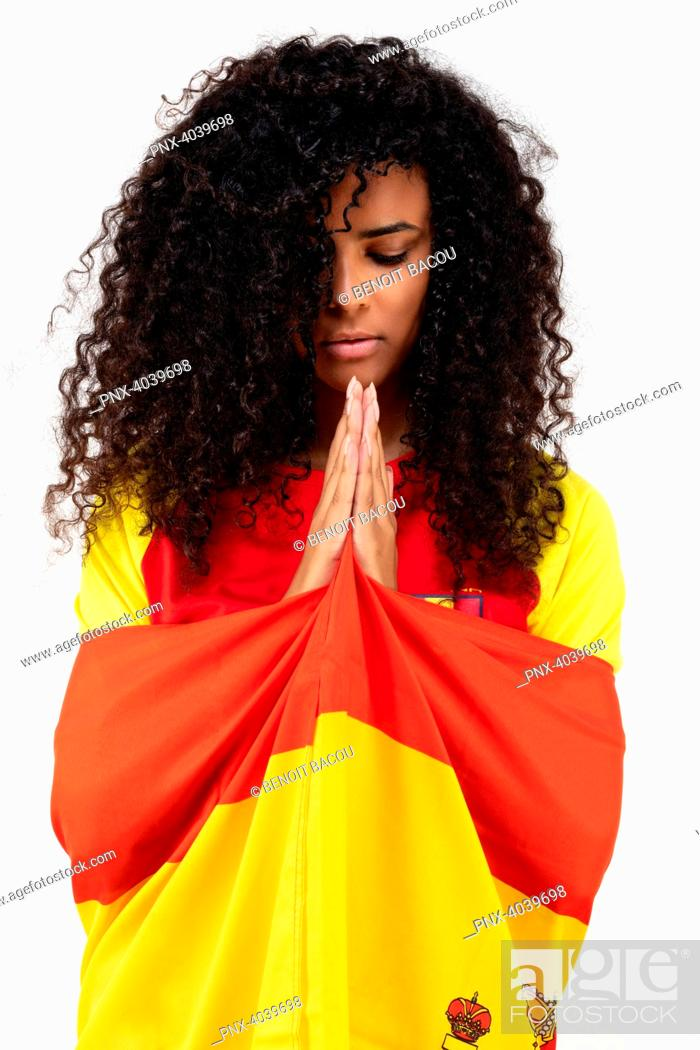 Stock Photo: Portrait of a young supporter of the Spanish team praying for his team.