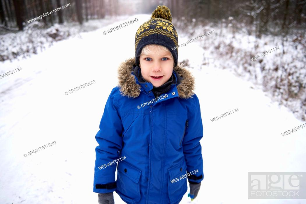 Stock Photo: Portrait of little boy enjoying walk in winter forest.