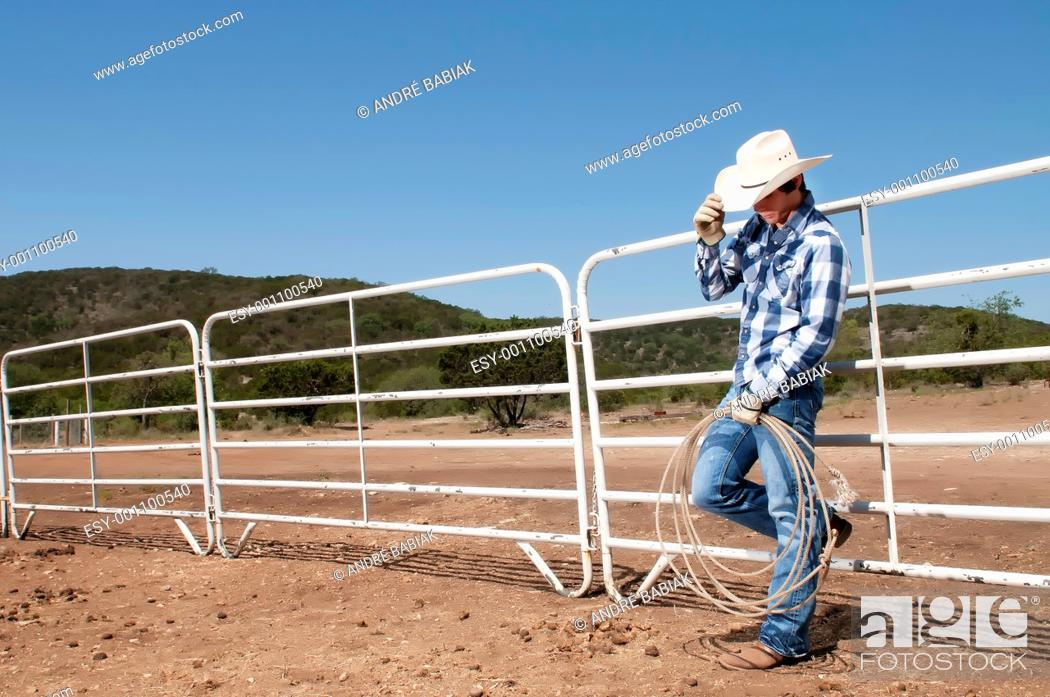 Stock Photo: Texas cowboy with hat and boots.