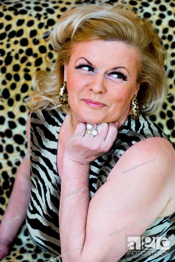 Stock Photo: portrait of an older blond woman with tigerpattern top.
