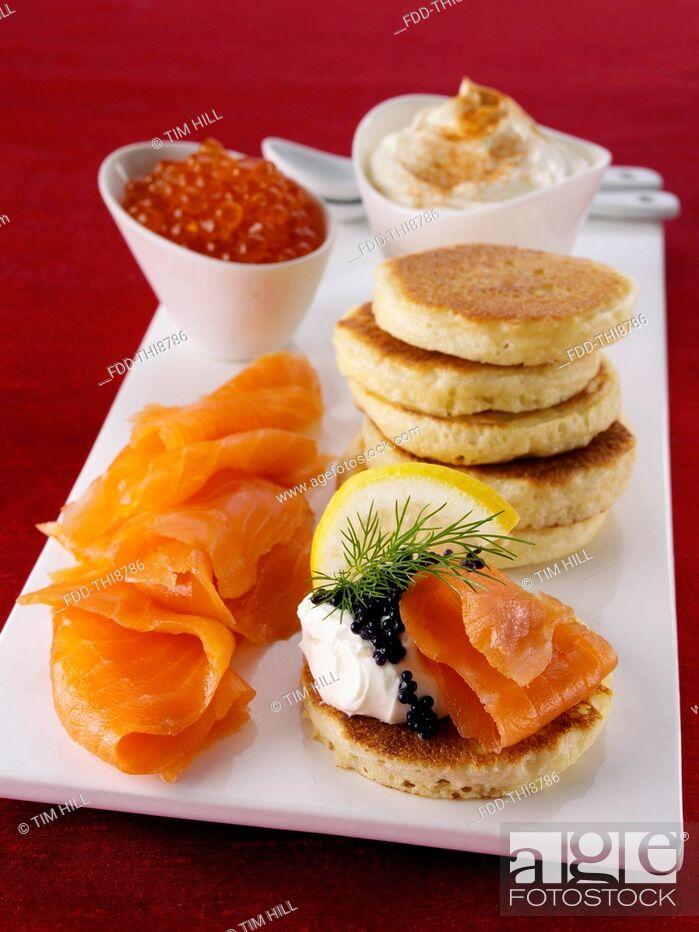 Stock Photo: Blini with smoked salmon salmon roe and cream cheese.