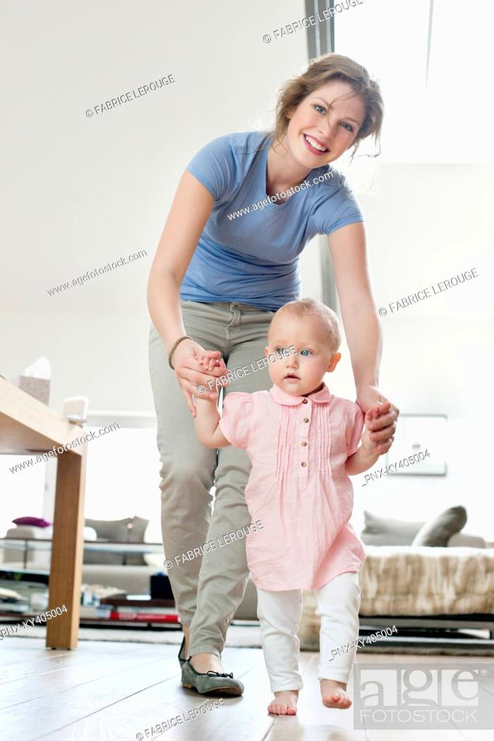 Stock Photo: Mother helping baby to walk.
