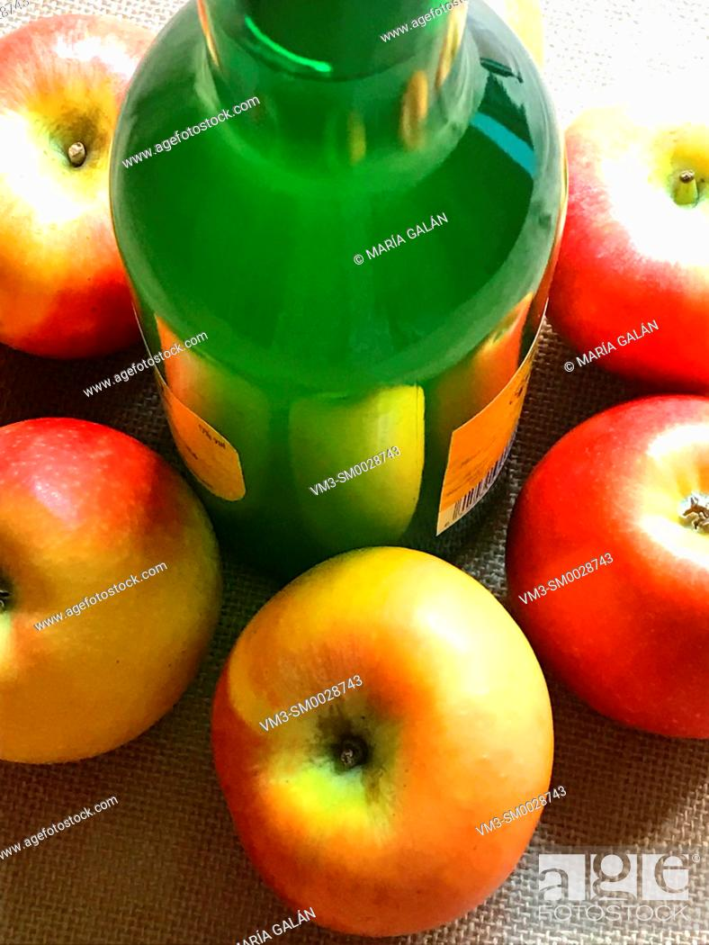 Stock Photo: Bottle of cider with apples. Asturias, Spain.
