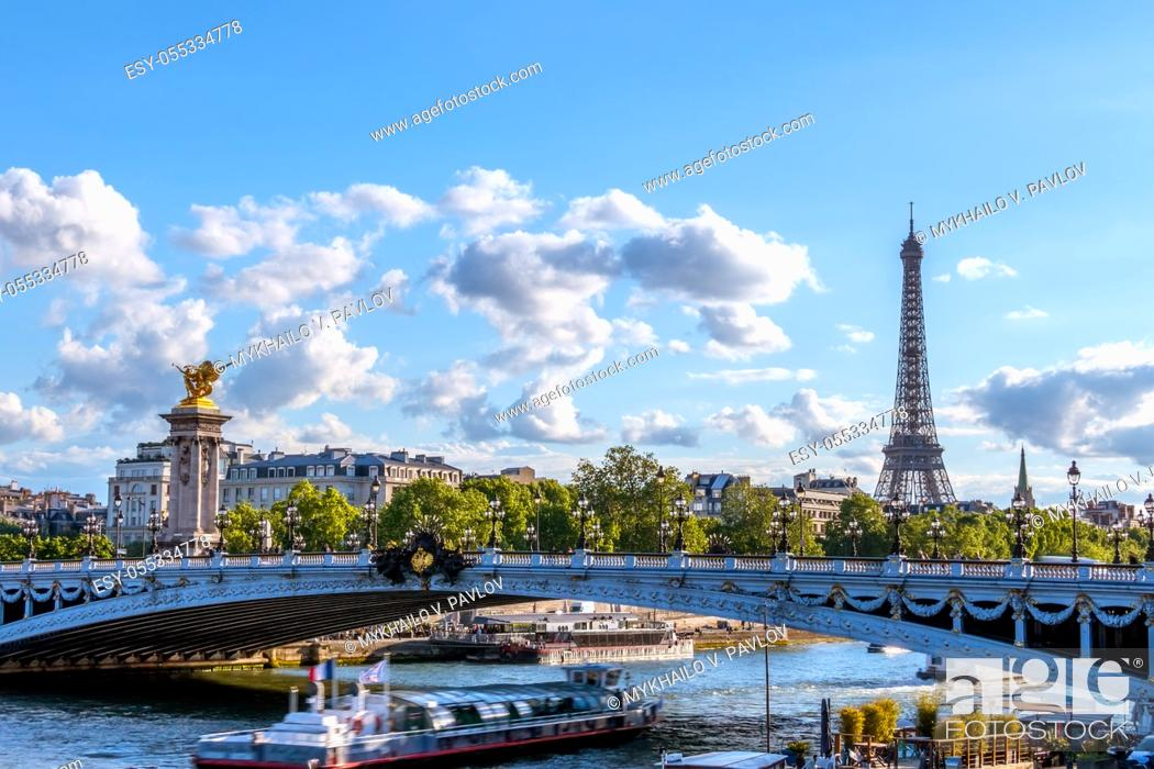 Stock Photo: France. Sunny summer day in Paris. Pleasure boat under the bridge of Alexander III over the river Seine. Eiffel Tower.