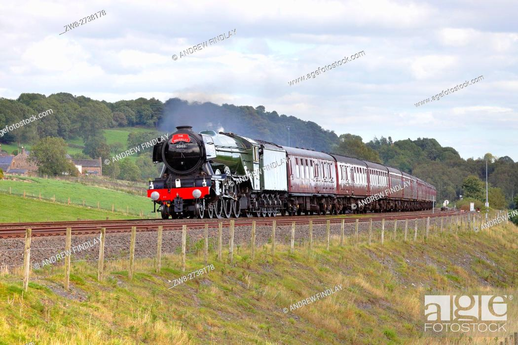 Stock Photo: Flying Scotsman steam train LNER A3 Class 4-6-2 no 60103 heading to Carlisle on the last run of 'The Waverley' rail tour for this year.