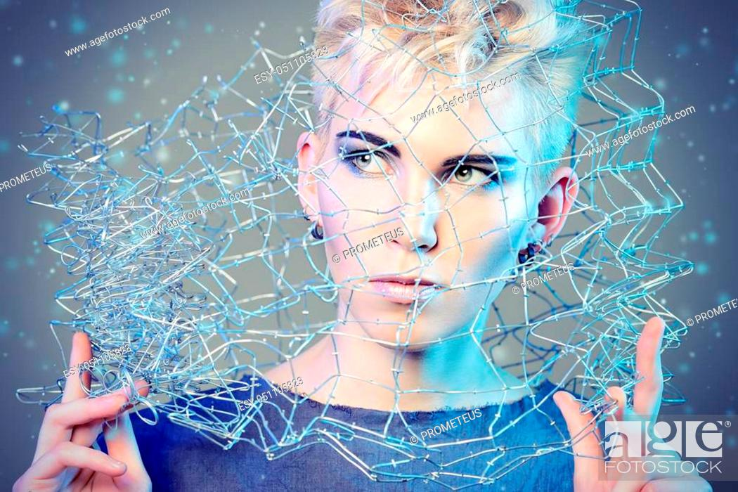Stock Photo: Fashionable designer collection with the use of metal wire. Avant-garde style. Futurism. Studio shot.
