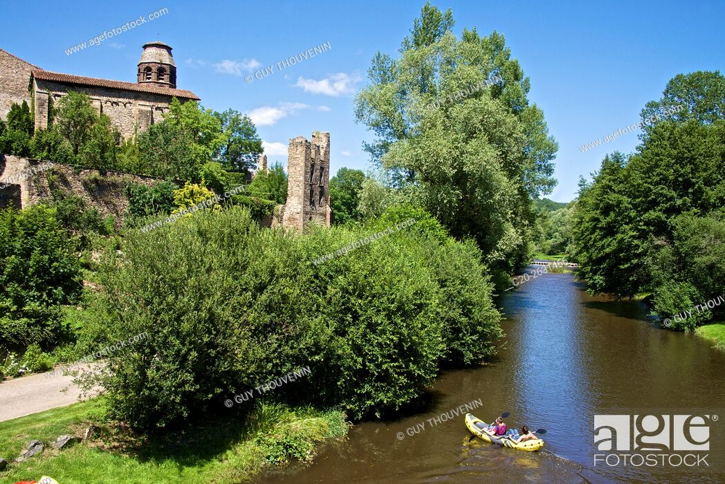 Stock Photo: Ruins and benedictine abbey tower, along the Senouire river, and canoeing, at Lavaudieu, medieval village, 43, Auvergne, Haute Loire, France.