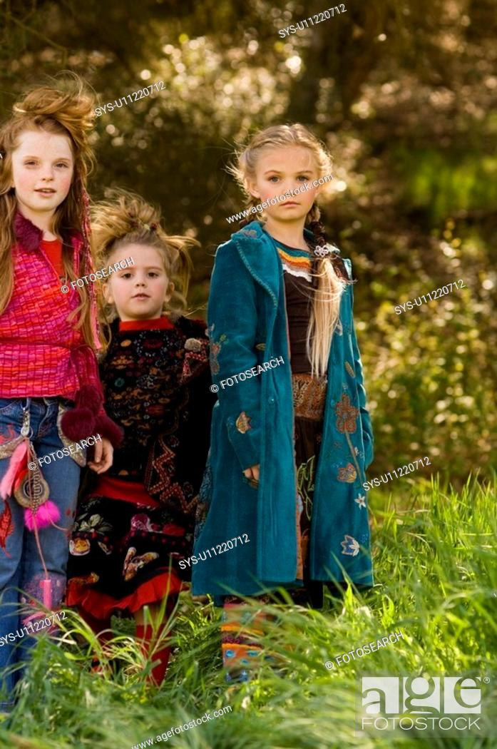 Stock Photo: Portrait of young girls outside.