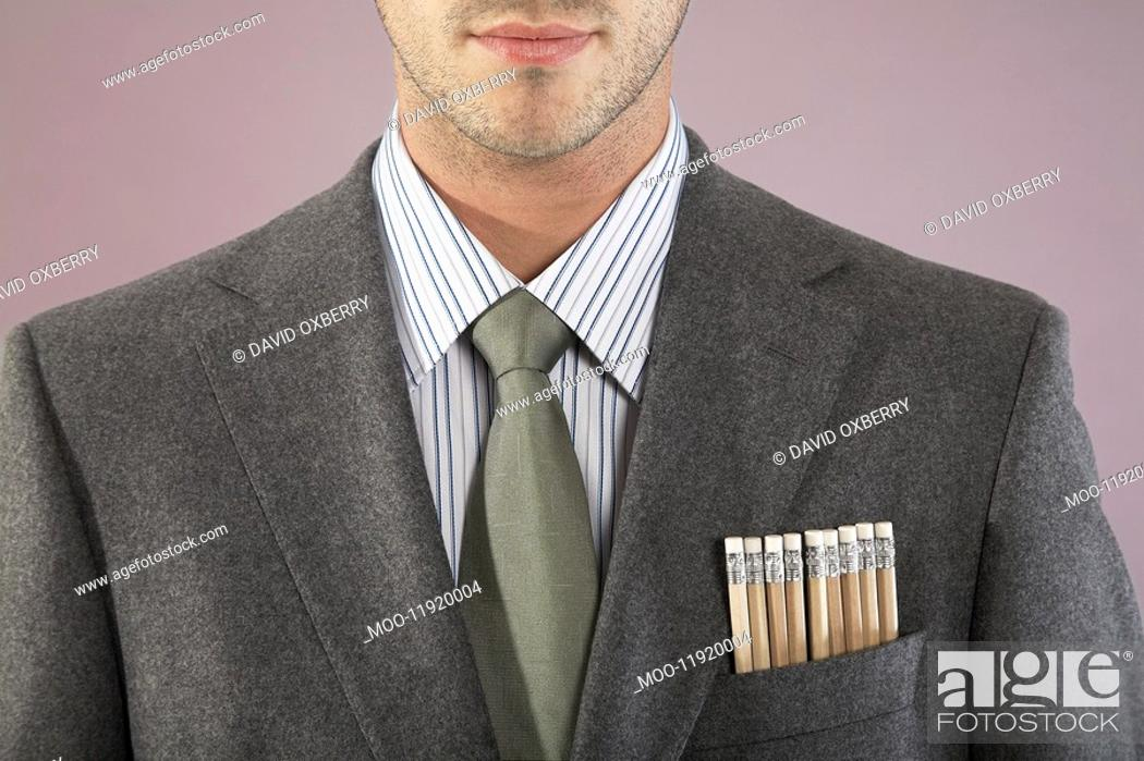 Stock Photo: Young businessman with pencils in pocket close-up portrait.