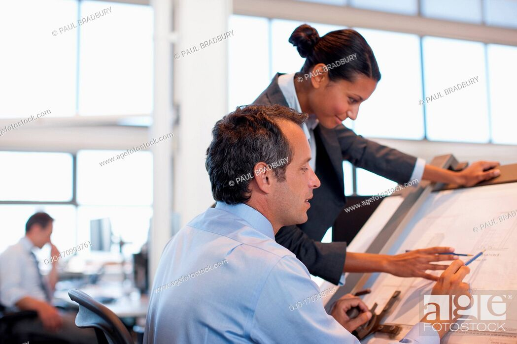 Stock Photo: Business people with blueprints and model building.