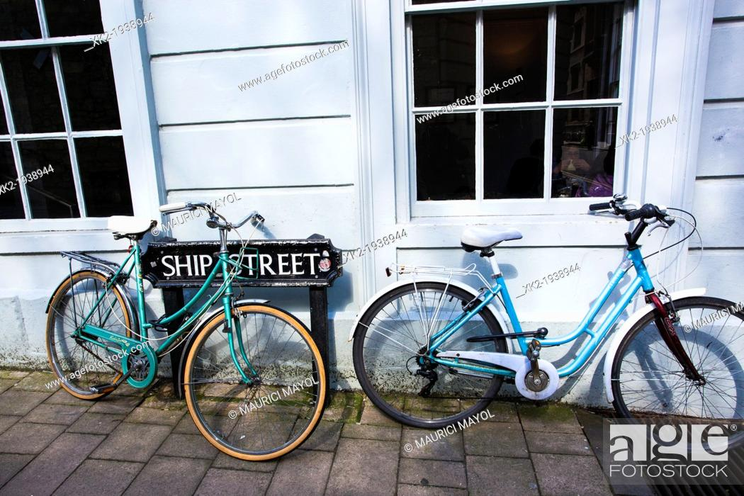 Stock Photo: Two Blue stroll dutch bikes parked in front of a street sign, Oxford, UK.