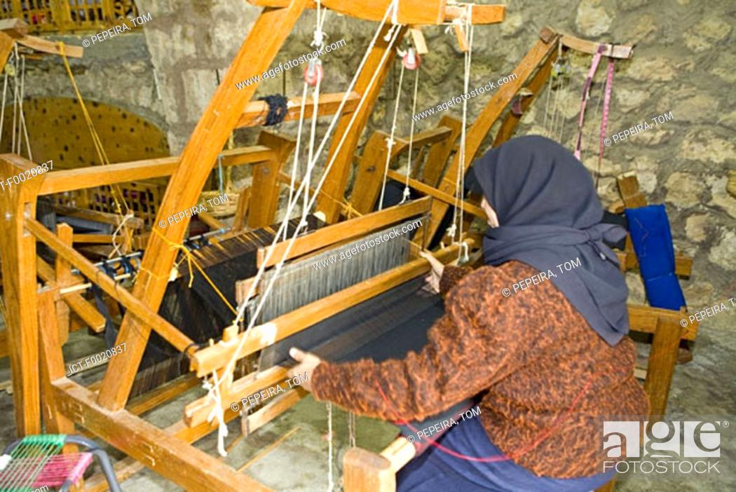 Stock Photo: Jordan, Iraq al Amir, woman weaving cotton linen.