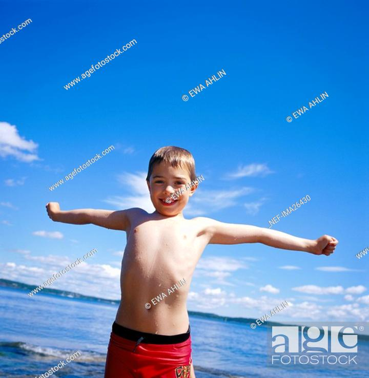 Stock Photo: A boy wet from a swim.