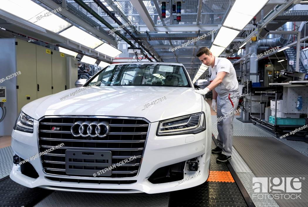 Audi AG employee conducting the first run of an assembled A8