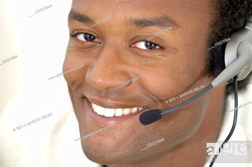 Stock Photo: Close-up black man, Telemarketing.