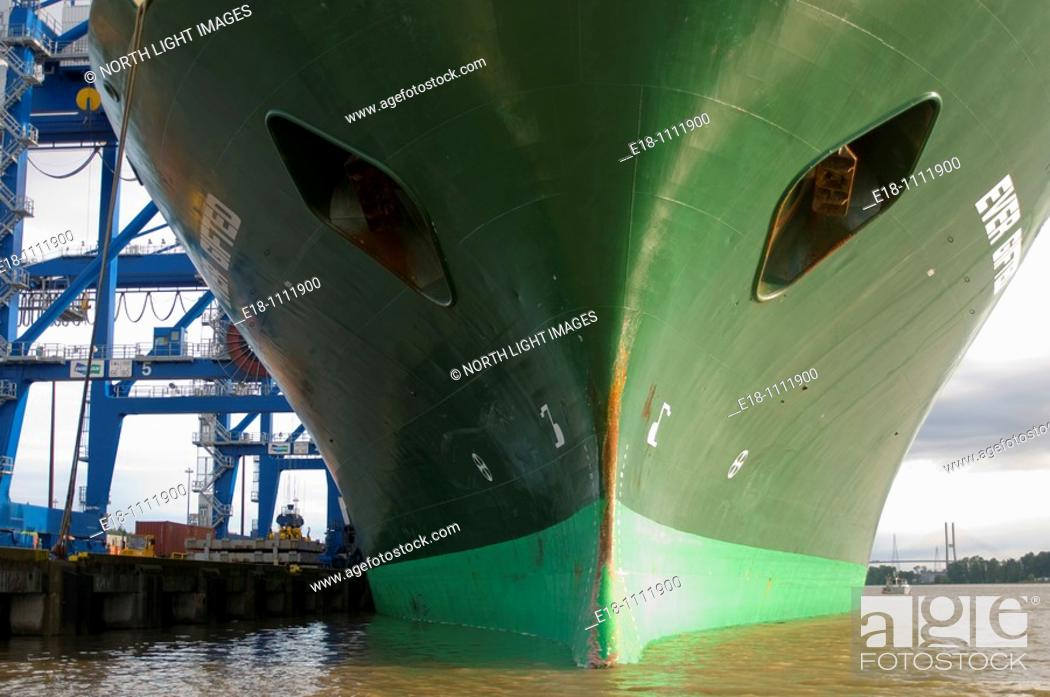 Stock Photo: Canada, BC, Surrey.  Bow of large green freighter docked at the Surrey Fraser Port container terminal.  On the lower Fraser River, near Vancouver.