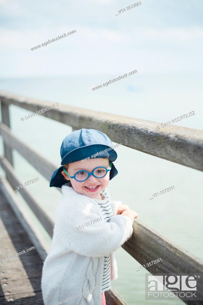 Stock Photo: 2 years old boy in a dock at the beach.