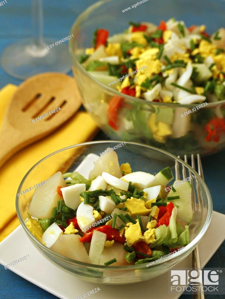 Stock Photo: Potatoes salad with veggies and eggs.