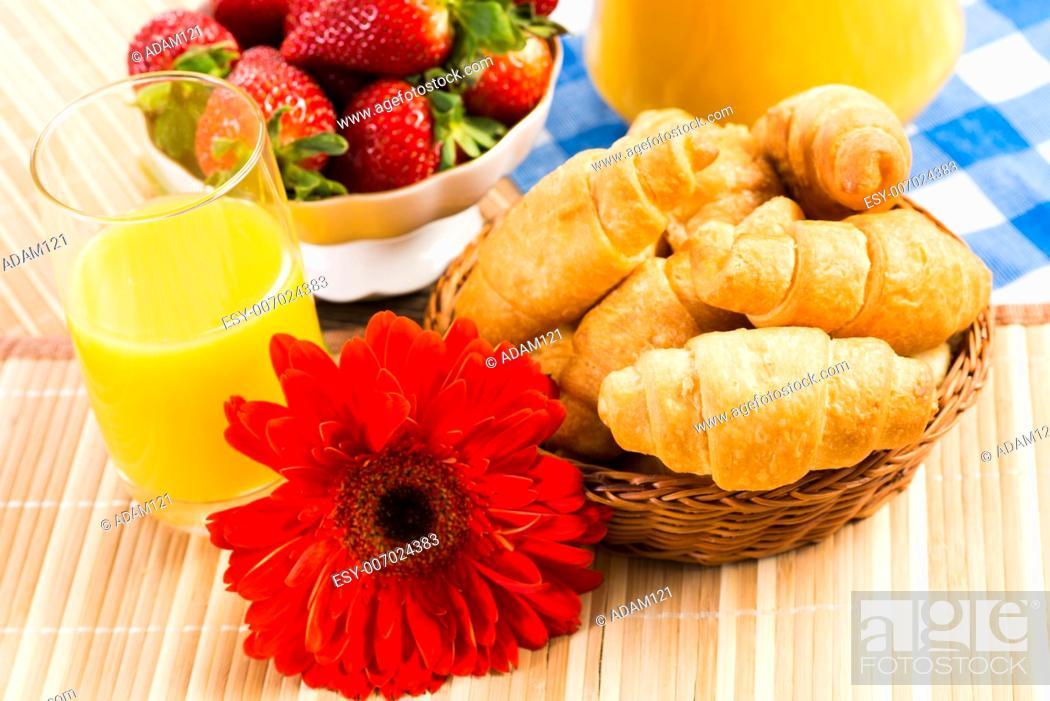 Imagen: early breakfast, juice, croissants and Berries, still life.