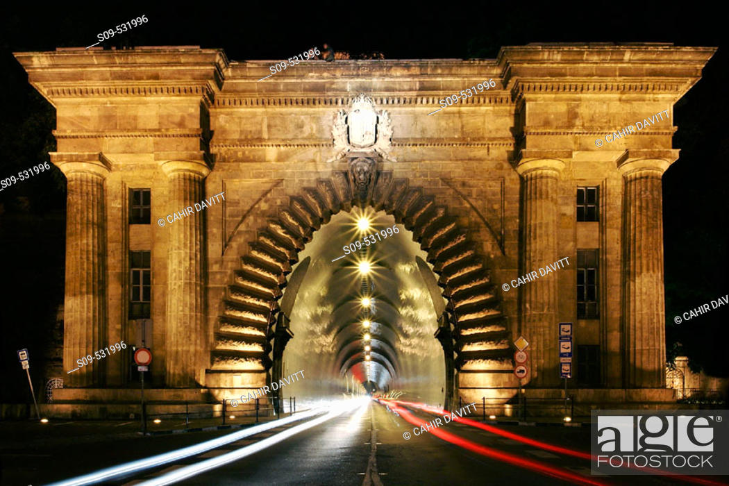 Stock Photo: The monumental entrance to the road tunnel that runs through Castle Hill on Clark Adam Ter by night, Budapest, Hungary.