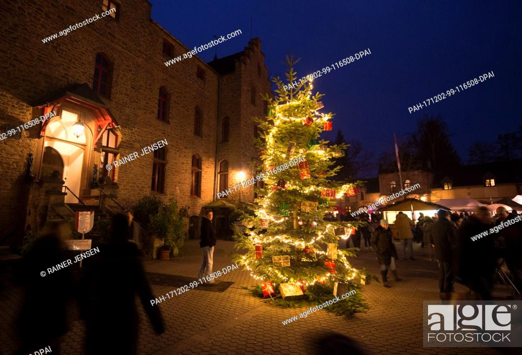 Stock Photo: Visitors at the Christmas market at Satzvey Castle in Satzvey, Germany, 2 December 2017. Photo: Rainer Jensen/dpa. - Satzvey/Nordrhein-Westfalen/Germany.