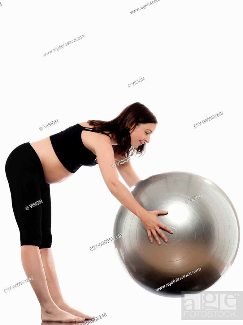 Stock Photo: pregnant caucasian woman stretching with fitness ball isolated studio on white background.