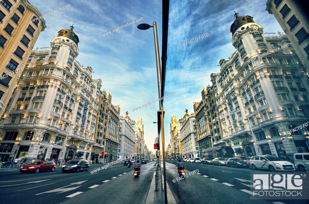 Imagen: Reflection on a window in Gran Via Avenue. Madrid. Spain.