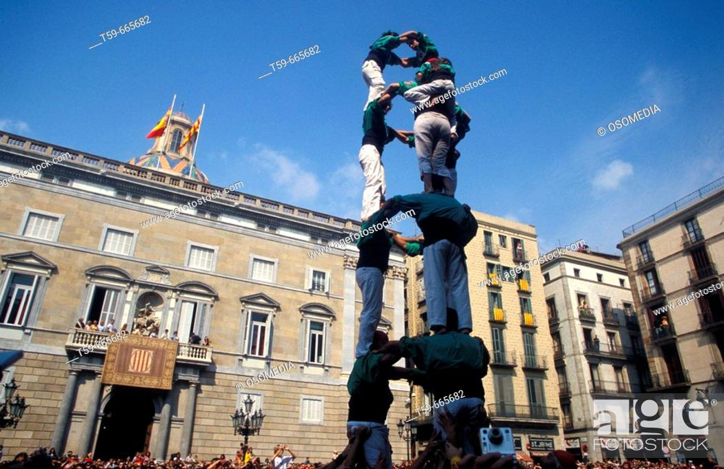 Stock Photo: 'Castellers', human tower, arising in front of town hall during the Mercé festival. Barcelona. Spain.