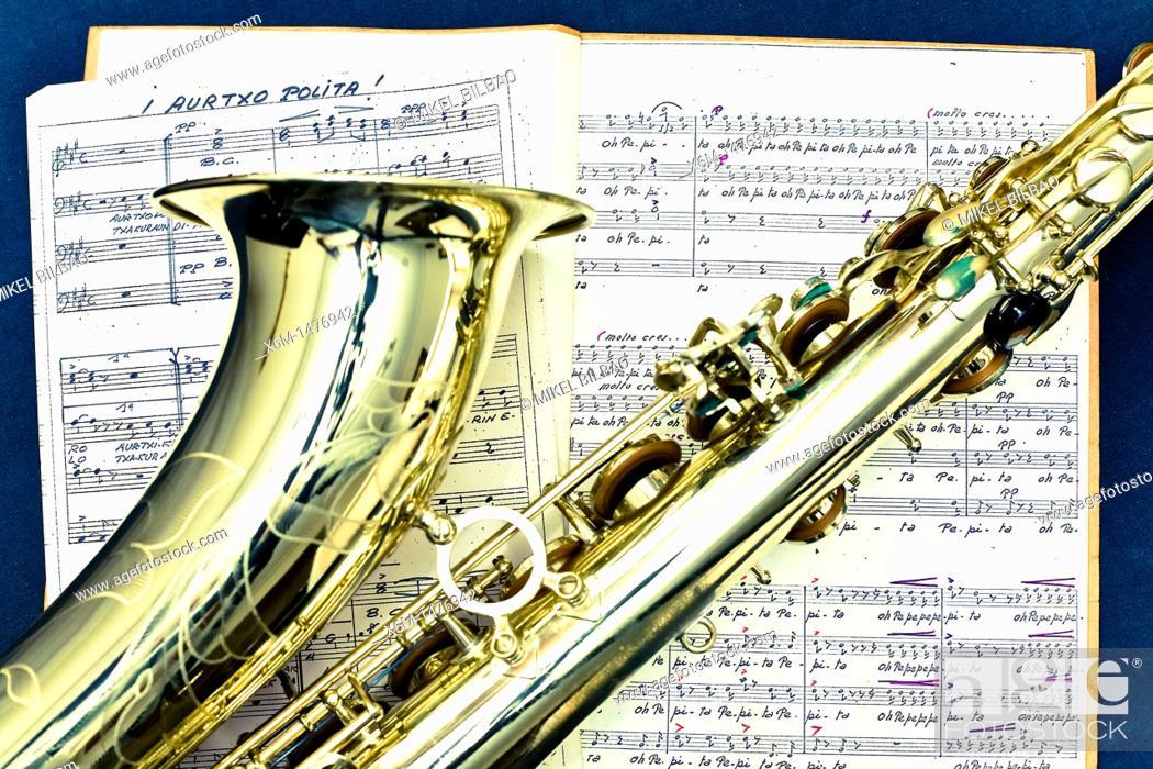 Stock Photo: saxophone and score.